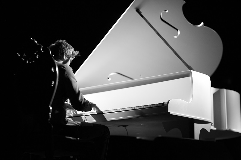 musician playing the grand piano