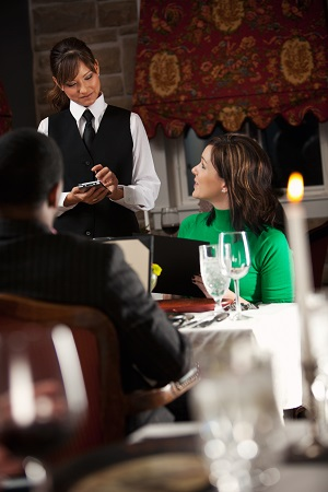 Restaurant: Waitress Takes Order On Digital Tablet